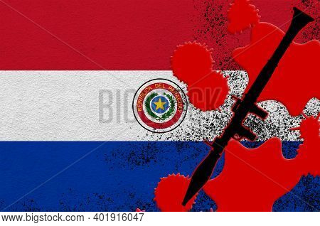 Paraguay Flag And Black Rpg-7 Rocket-propelled Grenade Launcher In Red Blood. Concept For Terror Att