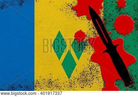Saint Vincent And The Grenadines Flag And Black Tactical Knife In Red Blood. Concept For Terror Atta