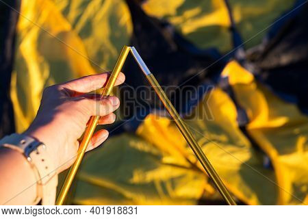 Aluminum Mounting Arcs For The Installation Of A Tourist Yellow Tent In The Hand Close-up. Lightweig