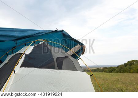 Installed Tourist Tent In Nature In The Forest. Domestic Tourism, Active Summer Holidays, Family Adv