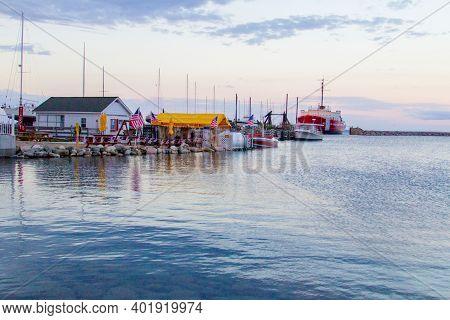 Mackinaw City, Michigan, Usa - May 29, 2020: Recreational Boats And Sailboat Line The Marina And Har