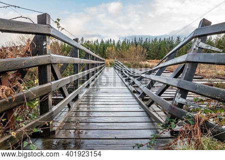 An Old, Rotten Wooden Bridge Over The Owenea River By Ardara In County Donegal - Ireland