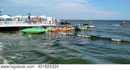 Odessa, Ukraine - June 22, 2019: An Unidentified Group Of Holidaymakers Is Ready For A Boat Trip On