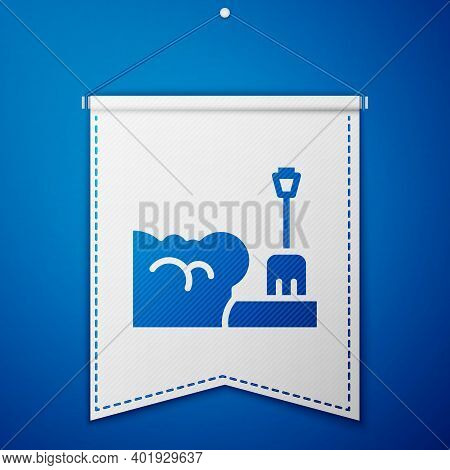 Blue Shovel In Snowdrift Icon Isolated On Blue Background. White Pennant Template. Vector