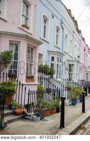 Row Of Colorful British Houses With Handrails And Plants