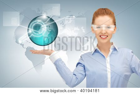 smiling woman showing virtual earth globe on the palm of her hand