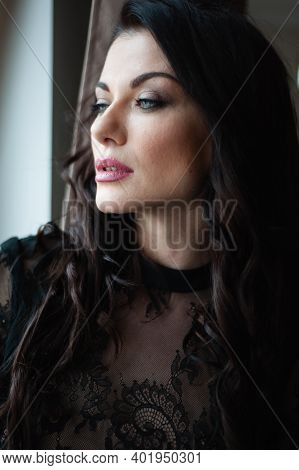 Exquisite elegant luxurious woman in evening dress, New Year's party or anniversary
