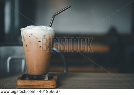 Iced Mocha Coffee In A Glass Decoration With Cream On Top On A Wood Table