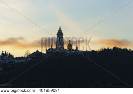 Picturesque Winter Landscape View Of Famous Kyiv's Hills Against Cloudy Sky During Sunset. Scenic La