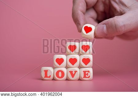 Love Valentine's Day Conceptman Hand Holding The Heart To Put On The Cube Wooden To Mean The Love On