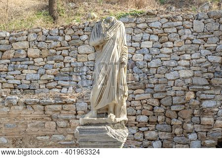 Headless Man Figure In Front Of Brick Wall In Ephesus Ancient City