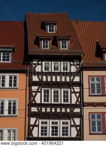 Exterior Facade Of Historic Old Traditional Half-timbered Colorful Houses Buildings In Erfurt Thurin