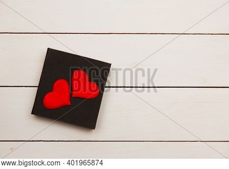 Flatlay Composition With Hearts On A Wooden Background.