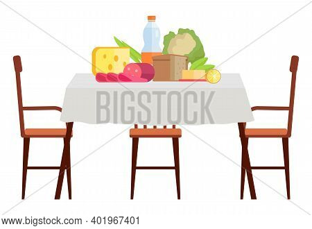 Wooden Dining Table Covered With A Table Cloth With Chairs Nearby. Furniture Model Made Of Wood For