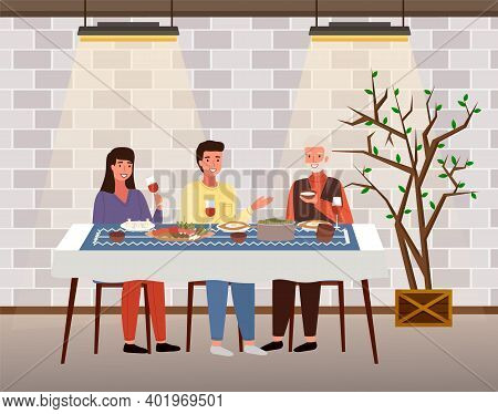 The Family Dines With Food In Georgian-style Restaurant. Relatives Eat Traditional Dishes In Cafe. G