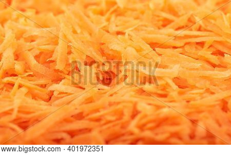 Soft Focus. Full Frame Of Grated Carrots. The Texture Of Grated Carrots. Food Background.
