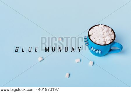 Blue Monday Concept. Blue Monday Text And Mug Of Cocoa With Marshmallows On Blue Background. Mug Is