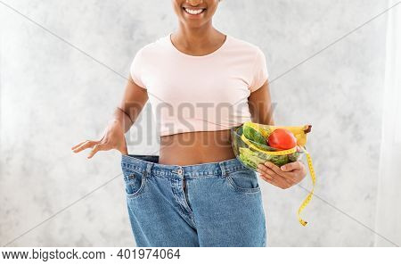 Slimming Diet. Cropped View Of African American Woman With Bowl Of Fruits, Veggies And Measuring Tap