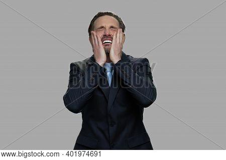 Distraught Stressed Businessman On Gray Background. Overhelmed Depressed Businessman. Bankruptcy Con