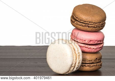 A Close Up Stack Of Chocolate, Strawberry And Vanilla Macaroons Or Macarons With Copy Space