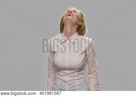 Young Business Woman Is Laughing Hard At Something Hilarious. Joyful Happy Woman Is Laughing At Funn
