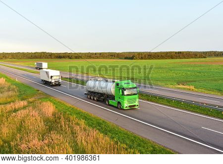 Tank Transport Of Liquid, Foodstuff. Metal Chrome Cistern Tanker For Food Transportation On Highway