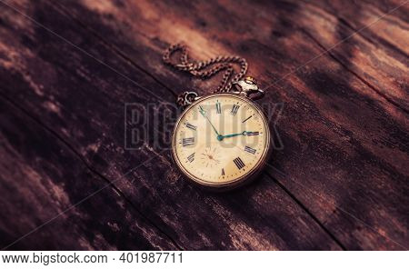 Vintage Pocket Watch On A Wooden Background