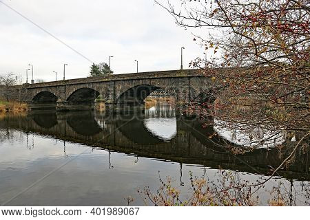 Reflections Of Stirling Old Bridge In Scotland