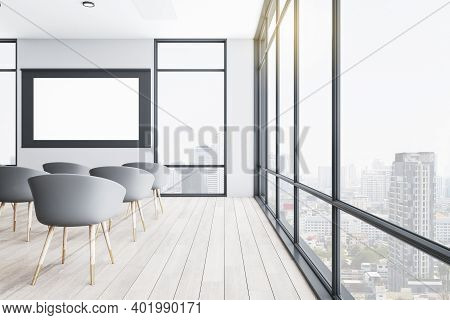 Modern Presentation Auditorium With Empty White Screen And Panoramic City View. Conference And Prese