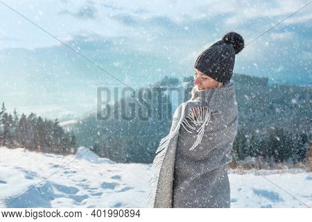 Happy woman traveler on the snowy of mountain look on the nice winter view in sunny cold day
