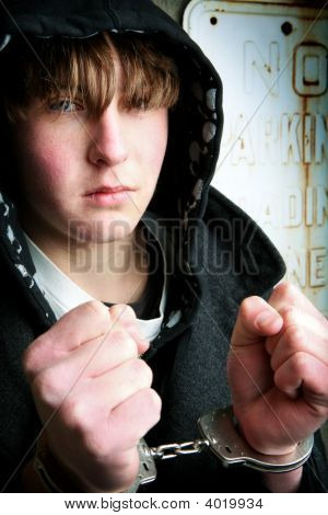 Teenager In Handcuffs