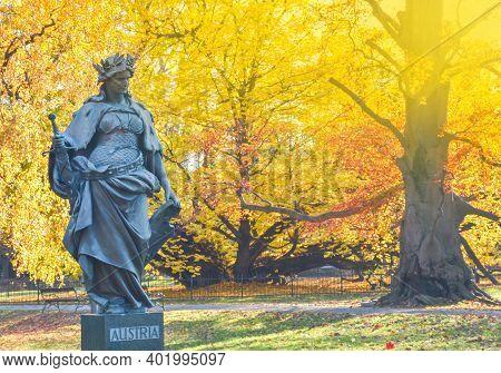 Graz, Austria-november 18, 2019;statue Representing Austria In The City Park Stadtpark, A Green Isla