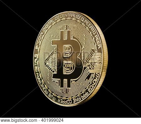 Golden Bitcoin Isolated On Black Background. Cryptocurrency Golden Coin Bitcoin Symbol