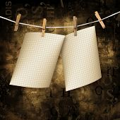 Old sheets hanging on a rope and clothespins on the brown abstract background poster