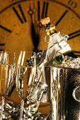 Champagne in bucket with glasses ready for New Years festivities poster