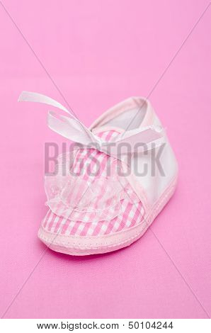 Pink bootie with bow and frills in vertical format poster