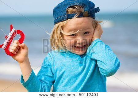 Happy Cute Boy Flying Kite