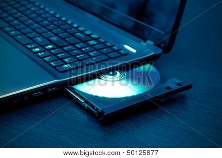 Laptop With Open Cd - Dvd Drive. Abstract Light Composition