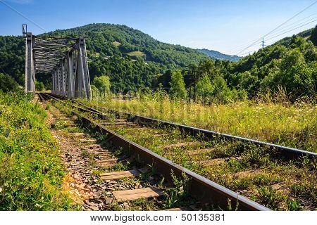 Rail Metal Bridge In Mountains