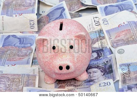 Piggy Bank over bed of notes