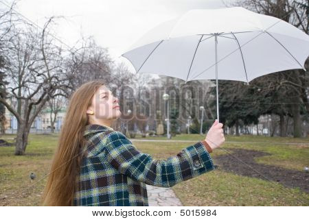 The Young Beautiful Woman In A Park