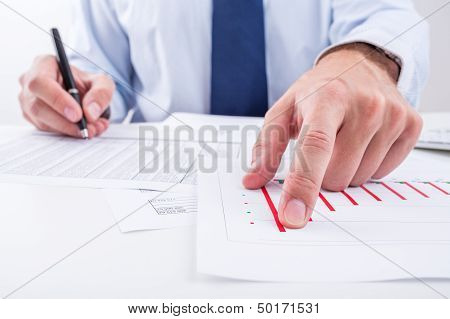 Businessman analyzing charts.