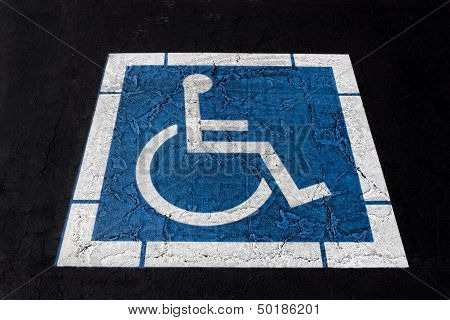 Handicapped Symbol Painted On Ashpalt
