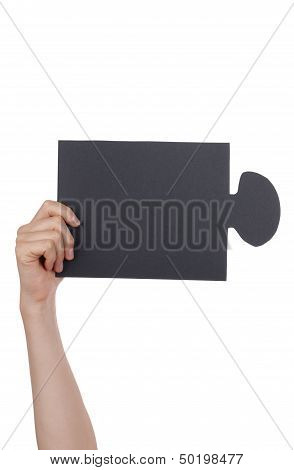 People Holding A Black Puzzle
