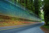 Forest Traffic - Redwood Forest in Northern California USA and Truck in Motion ( Long Exposure Photography ) Traffic Theme poster