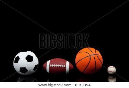Sports Balls On A Black Background