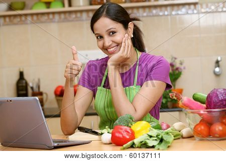 Young Woman Making Thumbs Up Gesture