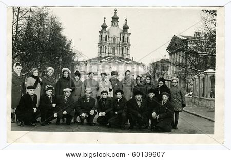LENINGRAD (now St. Petersburg), USSR - CIRCA 1970: An antique photo shows  group of tourists near the Smolny Palace
