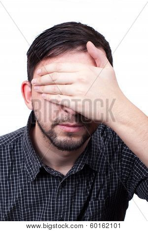 Young Man With Hand Over His Eyes Isolated On White Background