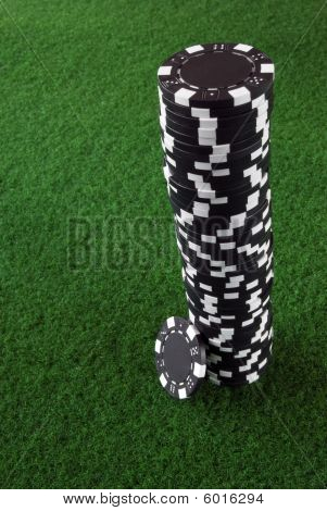 Black pile of poker chips